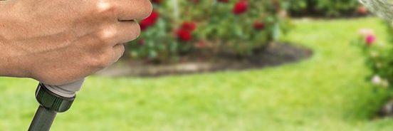 non-kink garden hose with spray nozzle in garden
