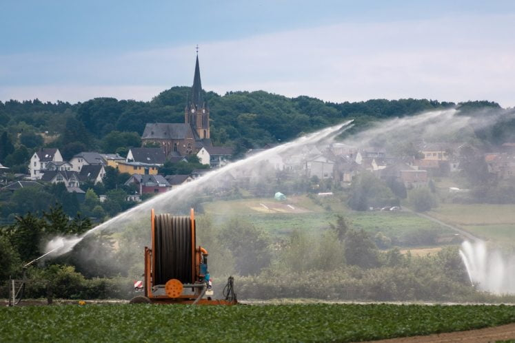 Watering hose being used for an agricultural application